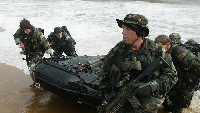 Navy SEALs land on the main beach in Monrovia, Liberia.