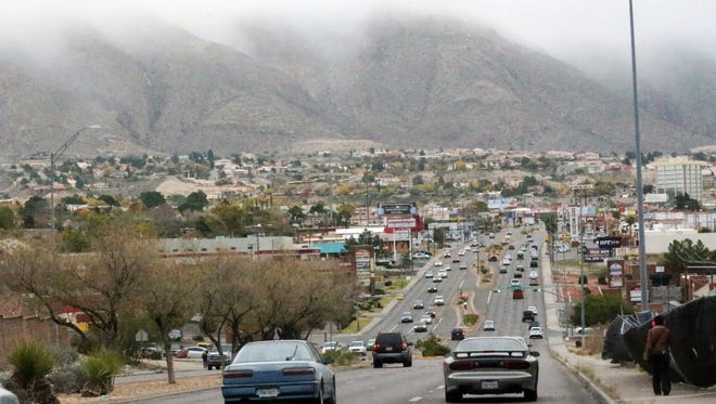 Clouds hang low Saturday over the western slopes of the Franklin Mountains in this view from North Mesa Street near the intersection with Cloudview Drive.