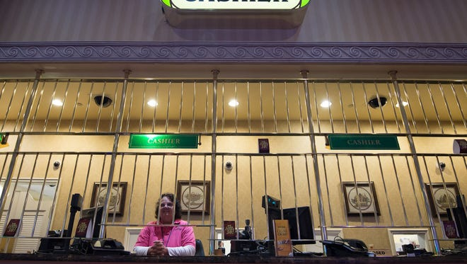 A cashier works at Dover Downs Hotel & Casino in Dover on May 27.