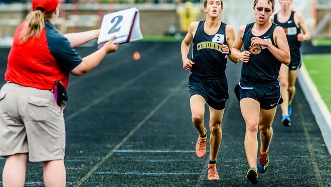 Noah Jacobs ,2, of Corunna laps a competitor in their 3200 meter run finals heat at the Division 2 state championships Saturday June 4, 2016 at Zeeland High School in Zeeland.  Jacobs set a new state record in the event, running 8:55.57 and finishing 30 seconds ahead of the 2nd place finisher.  KEVIN W. FOWLER PHOTO
