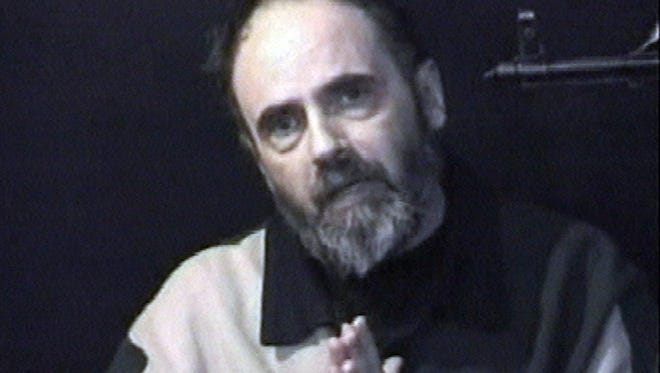 Roy Hallums of Memphis in an image taken from video released by his Iraqi kidnappers in 2005. Hallums was held captive for 311 days before he was rescued by U.S. forces.