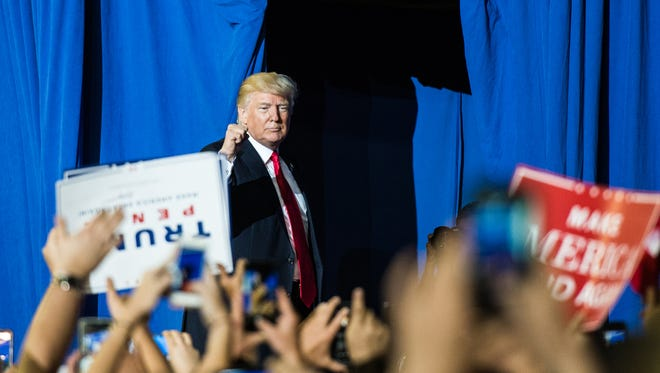 President Donald Trump leaves the stage after his a rally at the Farm Show Complex in Harrisburg on Saturday, April 29, 2017, the 100th day of his presidency.