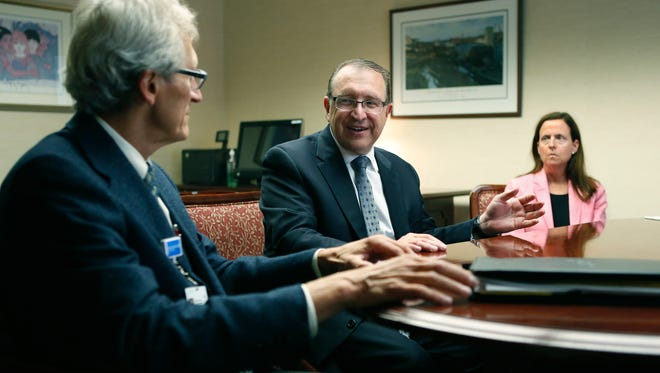 Dr. Eric Bieber, CEO of Rochester Regional Health System seats between Michael Nazar, executive vice president of Medical Groups and Janine Schue, executive vice president chief of Human Resources during a meeting at Rochester General Hospital.