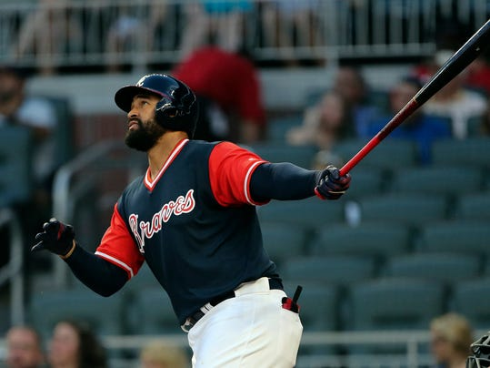 Atlanta Braves' Matt Kemp watches the flight of a two-run home run during the first inning of a baseball game against the Colorado Rockies on Friday, Aug. 25, 2017, in Atlanta. Kemp is returning to the Los Angeles Dodgers as part of a five-player trade with the Atlanta Braves that includes cash. (AP Photo/John Bazemore)
