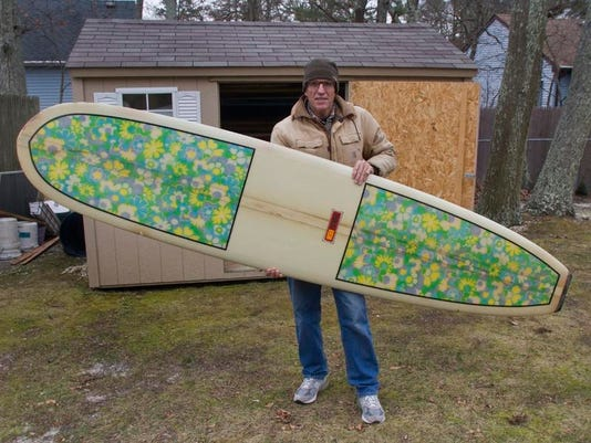 Bayville - Scott Edrington with one of a little more than a dozen surfboards he still has of his once