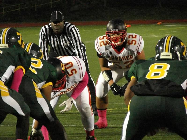 Shroder junior lineman Mike Mines, No. 52, gets ready for a play against Taft Oct. 17.
