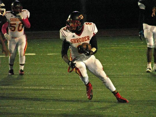 Shroder senior running back Tony Brown, who serves as a captain for his team, makes a run during a recent game.
