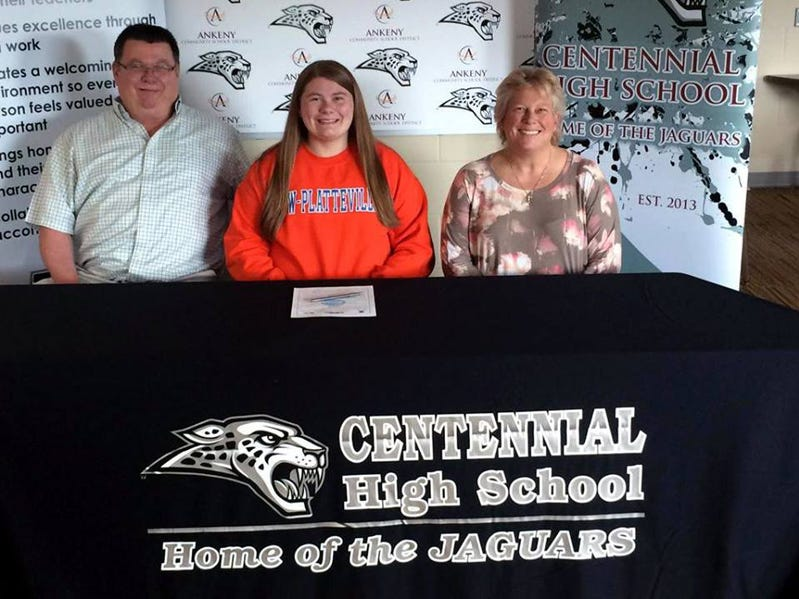 Ankeny Centennial senior Claire Nelson signs a letter of intent to play softball next year at the University of Wisconsin-Platteville. Nelson is shown with her parents, Lynn Nelson and Julie Nelson.