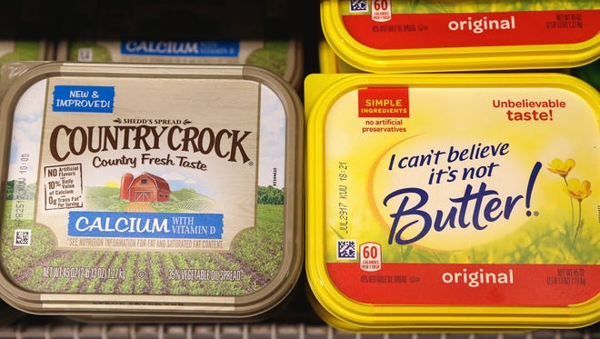 The owner of Country Crock and I Can't Believe It's Not Butter seeks someone to take the brands off its hands due to soft sales.