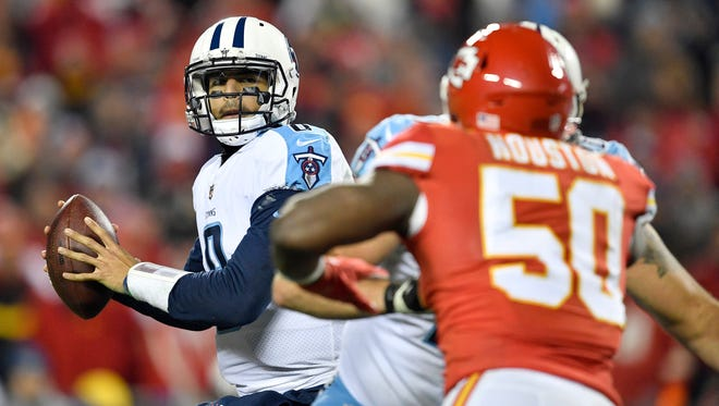 Titans quarterback Marcus Mariota (8) looks to throw during the fourth quarter of the team's 22-21 win over the Chiefs on Saturday at Arrowhead Stadium.