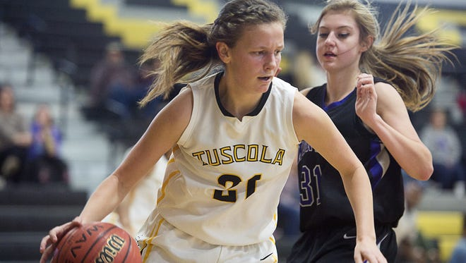 Shelby Glance (21) was the leading scorer for the Tuscola girls on Friday with 16 points.