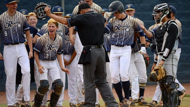 Roberson's Spencer Keehan celebrates with teammates after hitting a grand slam in Friday's fourth round of the NCHSAA 4-A baseball playoffs.