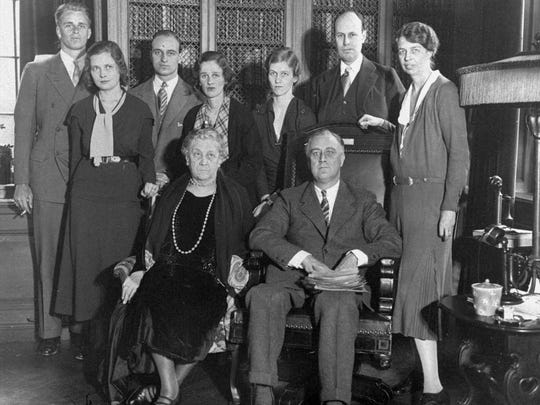 Surrounded by his family and away from the political atmosphere for a day, Franklin D. Roosevelt, New York's governor and presidential aspirant, spent his 50th birthday at his home at Hyde Park Jan. 30, 1932. Left to right, standing: Elliott Roosevelt, son; Mrs. Elliott Roosevelt; James Roosevelt, another son; Mrs. James Roosevelt; Mrs. Curtis Dall, daughter; Curtis Dall; and Mrs. Franklin D. Roosevelt. Front row: Mrs. Sara Delano Roosevelt, mother, and FDR.