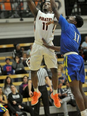 JOSEPH A. GARCIA/THE STAR Ventura College's Elijah Brown (left) shoots a basket over Hancock College's Malik Rhodes (right) during a game at Ventura College on Saturday evening, January 16, 2016. 01/16/2016 Ventura, CA