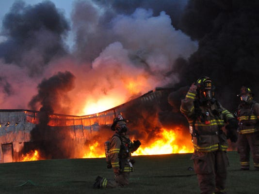 Firefighting crews work to control a fire at the Miller Chemical and Fertilizer Company building in Adams County, near Hanover, Pa., in the early morning hours of Monday, June 8, 2015. At least six companies battled the fire and heavy smoke for more than 10 hours. COURTESY OF 911 PHOTOGRAPHY