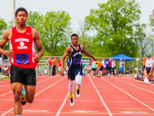 """West York's Abdul Junaid, center, trails the field in his 100-meter dash heat at Friday's District 3 Class AAA track and field championships at Shippensburg University. Junaid aggravated an injury int he event, ending his season. """"As soon as I got out of the blocks, it felt like someone was stabbing me in the leg,"""" he said."""