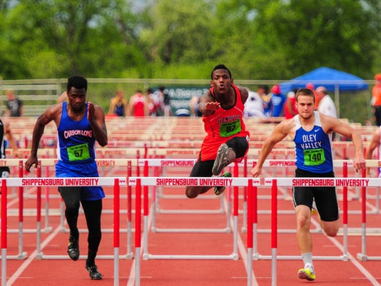 Hanover's Deandre Kerr competes in a trial heat of the 110-meter hurdles during the District 3 Class AA track and field championships Friday at Shippensburg University.