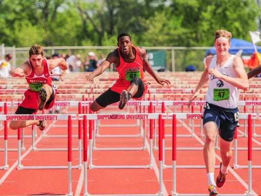 Hanover's Deandre Kerr competes in the 110-meter hurdles at Saturday's District 3 Class AA track and field championships at Shippensburg University. Kerr finished third in the event to wrap up a three-medal meet. He also was sixth in the 300 hurdles and earned fourth place in Friday's triple jump.
