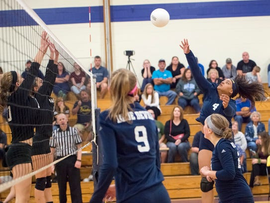 Greencastle's Chloe McKenzie (4) spikes the ball during