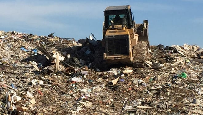 Construction waste is being buried atop a previously used portion of the landfill where household and commercial garbage was buried many years ago.