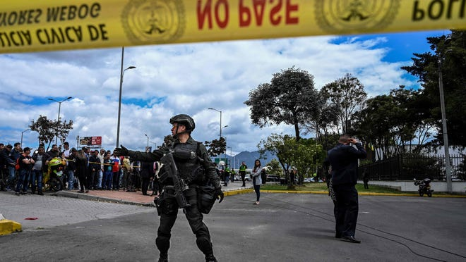 Security forces stand guard at the site of an explosion at a police academy in Bogota on Jan. 17, 2019.