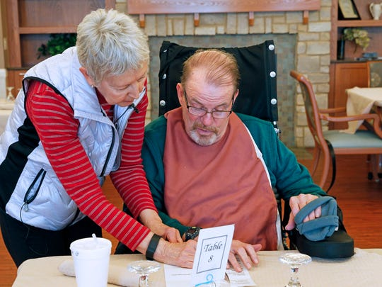 Marilyn Short helps her husband, Tom, select from the lunch menu at the Lake Country Health and Rehabilitation Center in Oconomowoc. Tom is recovering from a stroke he had in 2016.