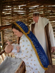 Brent and Brittany Tungett portray Joseph and Mary, with baby Mia in the role of Jesus. St. Agnes Catholic Church presented a Live Nativity outside their parish center on Saturday and Sunday, with a cast of over 100 taking viewers through the whole Advent story.