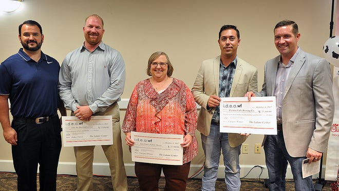 Winners of the i.d.e.a. WF entrepreneur competition are Scott Matthesen and Nathan Moore, left, of Take the Shot, Pam Schenk of Aunt Pam's Fabric Mecca, Matt Bitsche and Russ Reynolds of Wichita Falls Brewing Company. Their businesses receive thousands of dollars in cash and in-kind services.