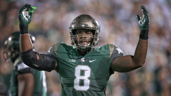 Mike Carter/USA TODAY Michigan State's defensive lineman Lawrence Thomas gestures to the sidelines during a September game at Spartan Stadium. Sep 12, 2015; East Lansing, MI, USA; Michigan State Spartans defensive lineman Lawrence Thomas (8) gestures to sidelines during the 1st half of a game at Spartan Stadium. Mandatory Credit: Mike Carter-USA TODAY Sports