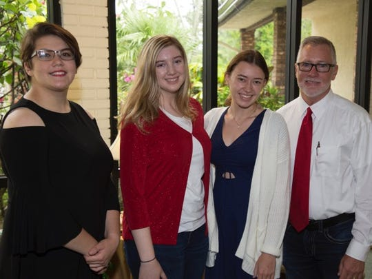 Riley Robson, left, Valerie Grau, and Parrish Davis-Sauls each recently received $1,000 scholarships from Dr. Douglas Jewett, director of Treasure Coast Community Singers.
