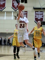 Michelle Sidor of Saddle River Day School flies to the basket.