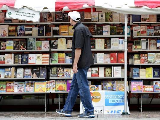 Barry Goheen checks out the different books at the