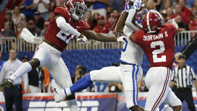 Alabama defensive backs Jared Mayden (21) and Patrick Surtain II (2) break up a pass intended for Duke wide receiver Jalon Calhoun (5) during game on Aug. 31, 2019 in Atlanta.