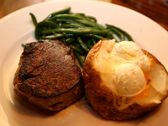 Filet, baked potato and green beans from Outback Steakhouse.