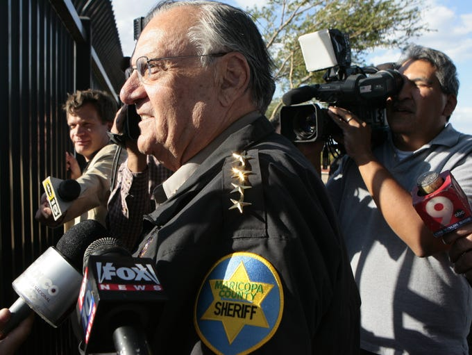 Maricopa County Sheriff Joe Arpaio speaks to protesters