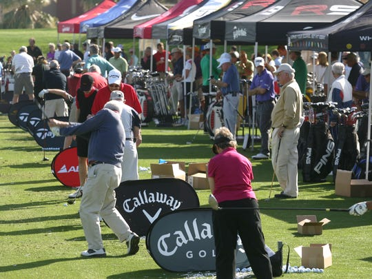 Golfer hit new golf clubs during last year's Pete Carlson's Golf & Tennis  Golf Expo at College of the Desert's Golf Center driving range.