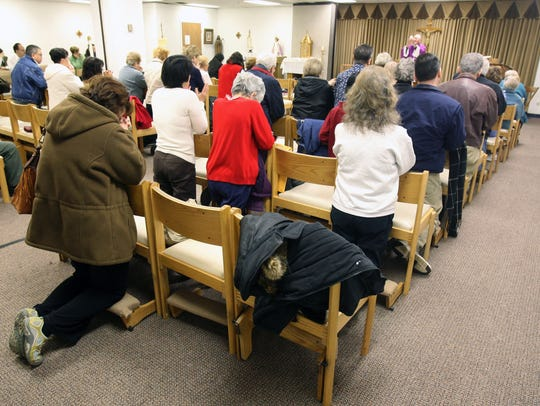 Parishioners of St. Therese chapel in the Bergen Mall