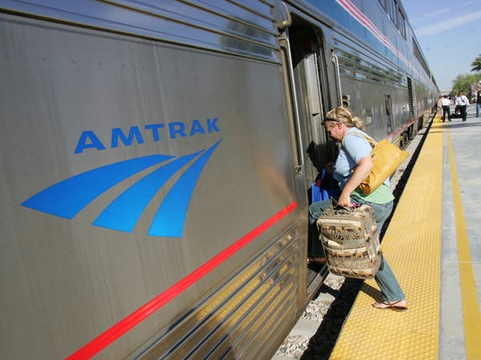 "Kris Dykema, of Vermont boards the 5:06 East bound Amtrak train at the Palm Springs station in May 2010. Plans to operate a special ""demonstration train"" to Indio during the two weekends of the Coachella Valley Music & Arts Festival have been cancelled.   (Richard Lui The Desert Sun)"