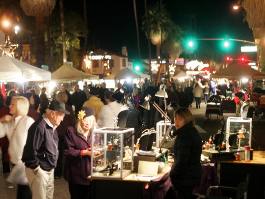Residents and tourists alike flock to Palm Springs for VillageFest along Palm Canyon Drive.