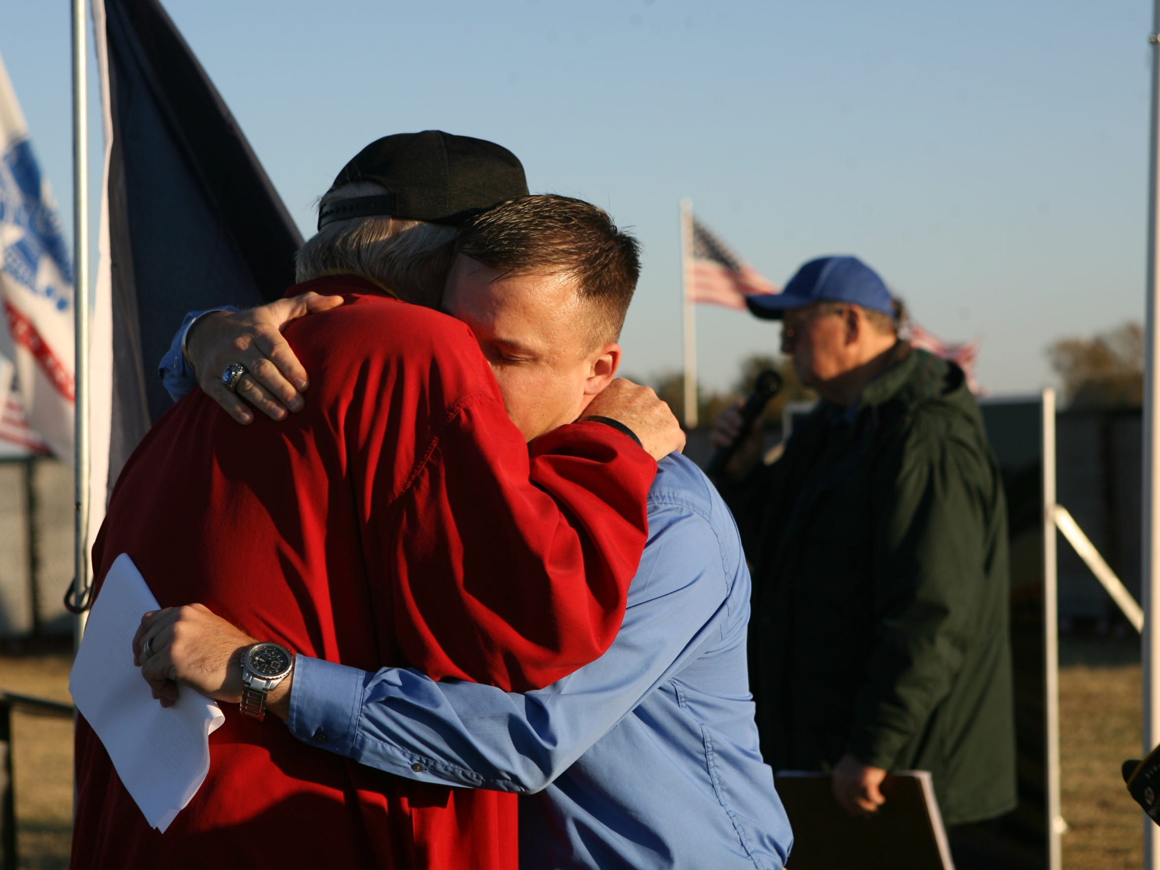 Ron Griggs, left, comforts Raymond Downs during the