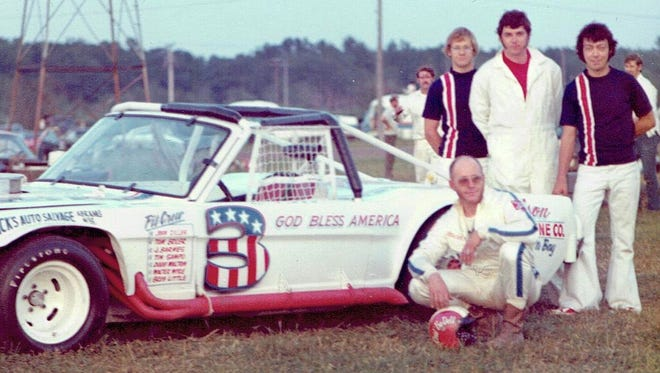 Green Bay's Red Bedell, shown with his pit crew at Shawano Speedway in 1973, died over the weekend. He was 80.
