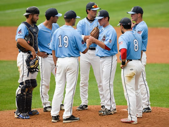 St. Cloud Rox players gather on the mound to plan their strategy with the bases loaded against Eau Claire during the second inning Thursday, July 7, at Joe Faber Field. The Rox got an out to safely end the inning.