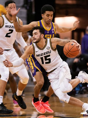 Missouri's Jordan Geist, bottom, drives past LSU's Tremont Waters, top, during the first half of an NCAA college basketball game Saturday, Jan. 26, 2019, in Columbia, Mo. (AP Photo/L.G. Patterson)
