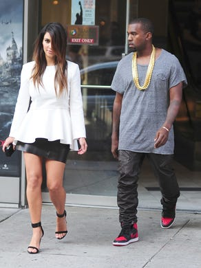 Kardashian and West walk out of a movie theater in Manhattan on Sept. 1, 2012.