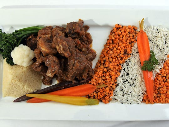 Senegalese Goat is served with rice at Lagniappe Brasserie