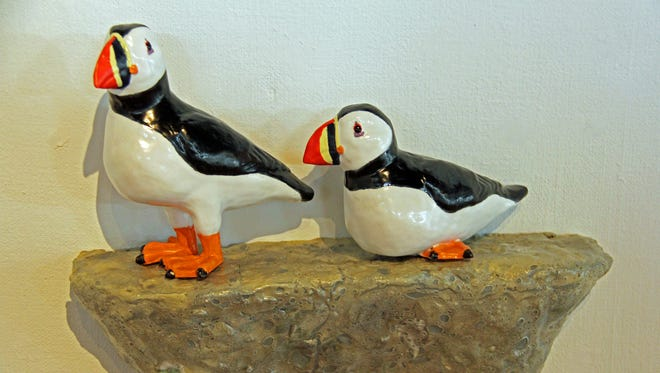 Detail of one of the puffin sculptures by artist Peter Morgan.