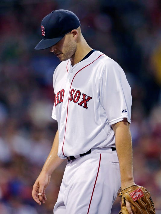 Boston Red Sox starting pitcher Justin Masterson (63) heads to the dugout as he is taken out of the baseball game during the fourth inning against the Houston Astros at Fenway Park in Boston, Friday July 3, 2015.  Masterson gave up five earned runs in the fourth. (AP Photo/Charles Krupa)