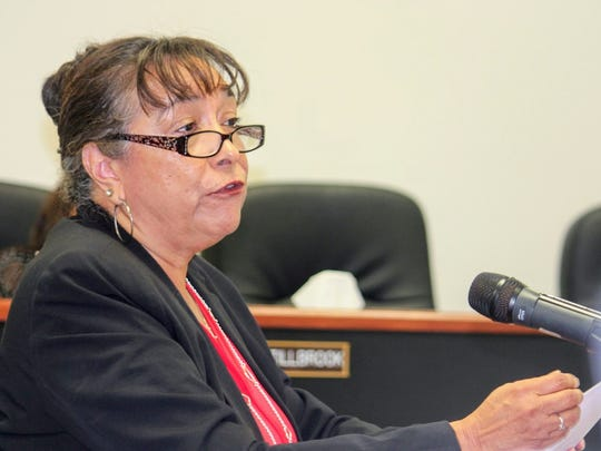 Vice President of the Office of Learning and Academic Opportunity at HELP-NM Gloria Lopez explained what HELP-NM is to County Commissioners at their regular county commission meeting Thursday.