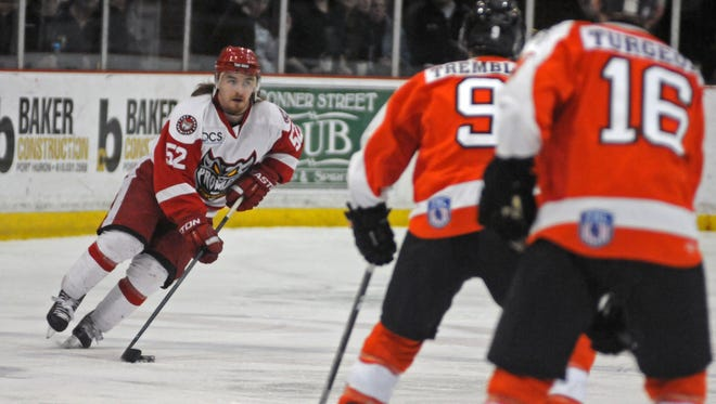 Prowlers' Len Pelletier skates up ice Sunday, April 10, during an FHL semifinal playoff game at McMorran Arena