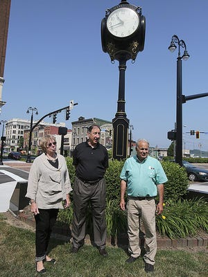 "Local historian Margy Vogt, Marshall Weinberg, board member of the Massillon Rotary Foundation, and Phillip Elum, director of Massillon Main Street, stand on the Massillon Museum grounds. The museum will serve as a starting point to the newly designed ""Health and History Trails,"" set to debut by this fall. The rotary club, museum and Main Street group are spearheading the trail effort."